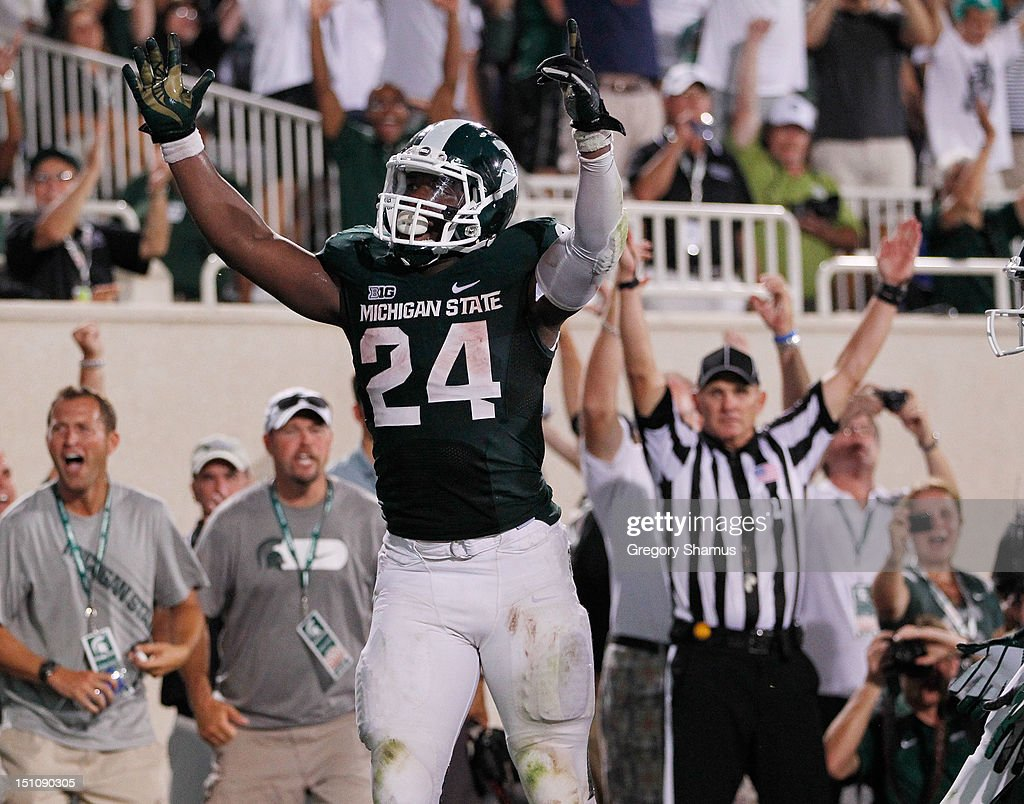 Le'Veon Bell #24 of the Michigan State Spartans celebrates a fourth quarter touchdown while playing the Boise State Broncos at Spartan Stadium on August, 2010 in East Lansing, Michigan.