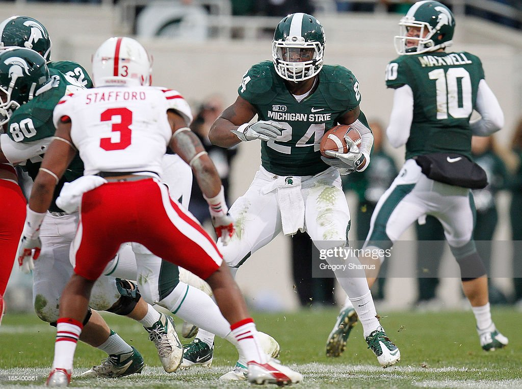 Le'Veon Bell #24 of the Michigan State Spartans looks to avoid the tackle of Daimion Stafford #3 of the Nebraska Cornhuskers during a third quarter run at Spartan Stadium Stadium on November 3, 2012 in East Lansing, Michigan. Nebraska won the game 28-24.