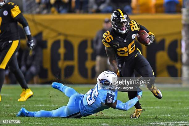 Le'Veon Bell of the Pittsburgh Steelers carries the ball against Jayon Brown of the Tennessee Titans in the first half during the game at Heinz Field...