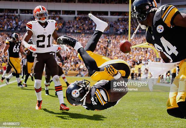 Le'Veon Bell of the Pittsburgh Steelers celebrates his touchdown in front of Justin Gilbert of the Cleveland Browns during the second quarter at...