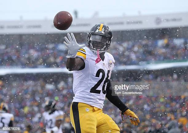 Le'Veon Bell of the Pittsburgh Steelers gets the ball back from the official after scoring his third touchdown of the game during NFL game action...