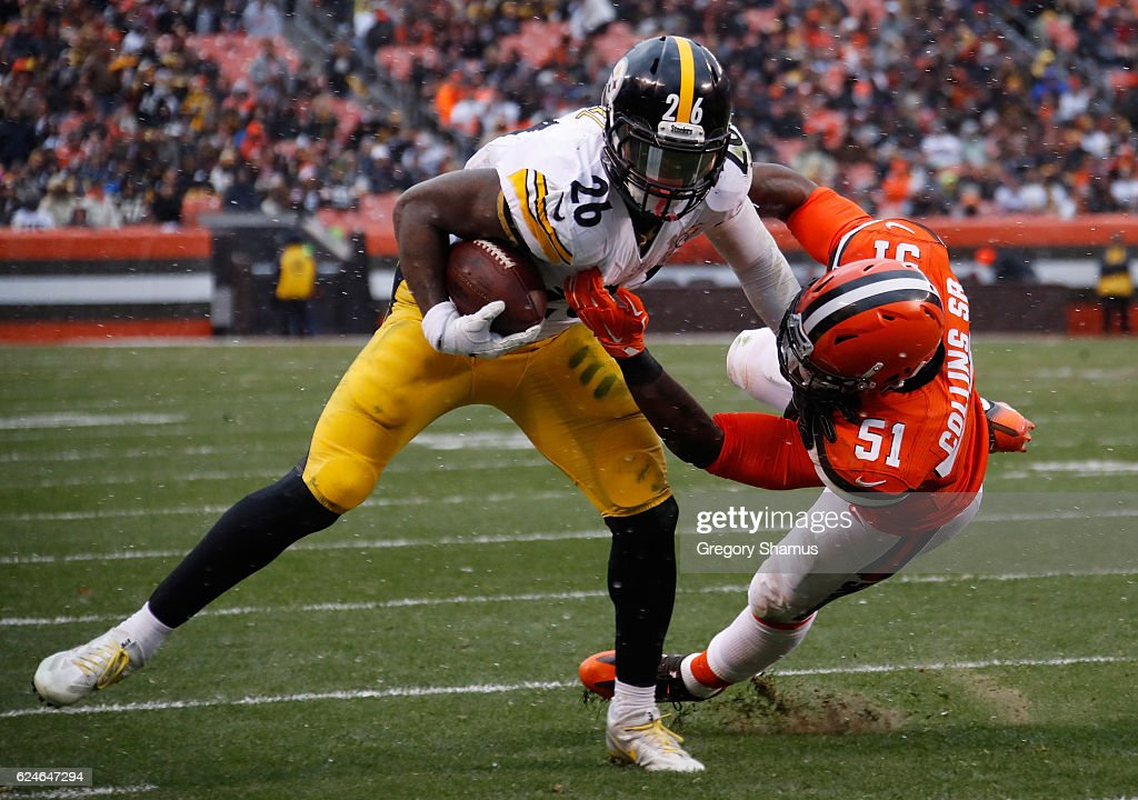 Le'Veon Bell #26 of the Pittsburgh Steelers is pushed out of bounds by Jamie Collins #51 of the Cleveland Browns during the second quarter at FirstEnergy Stadium on November 20, 2016 in Cleveland, Ohio.