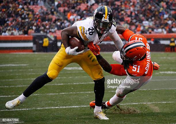 Le'Veon Bell of the Pittsburgh Steelers is pushed out of bounds by Jamie Collins of the Cleveland Browns during the second quarter at FirstEnergy...