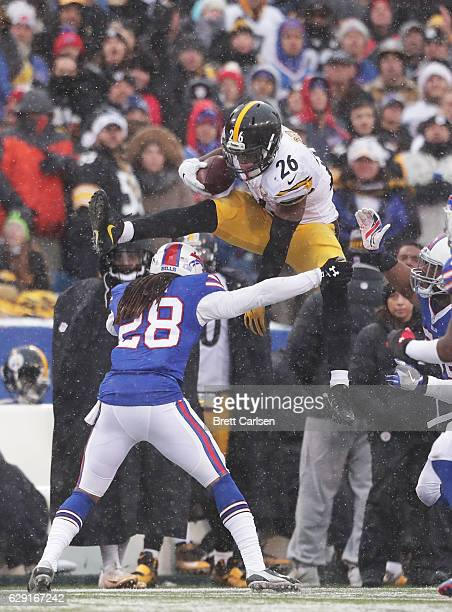 Le'Veon Bell of the Pittsburgh Steelers jumps over Ronald Darby of the Buffalo Bills during the second half at New Era Field on December 11 2016 in...