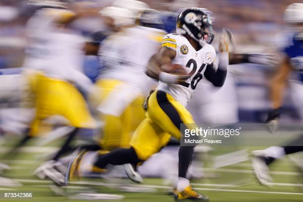 Le'Veon Bell of the Pittsburgh Steelers runs with the ball against the Indianapolis Colts during the first half at Lucas Oil Stadium on November 12...