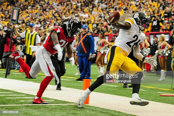 Le'Veon Bell of the Pittsburgh Steelers rushes for a touchdown past Desmond Trufant of the Atlanta Falcons in the second half at the Georgia Dome on...