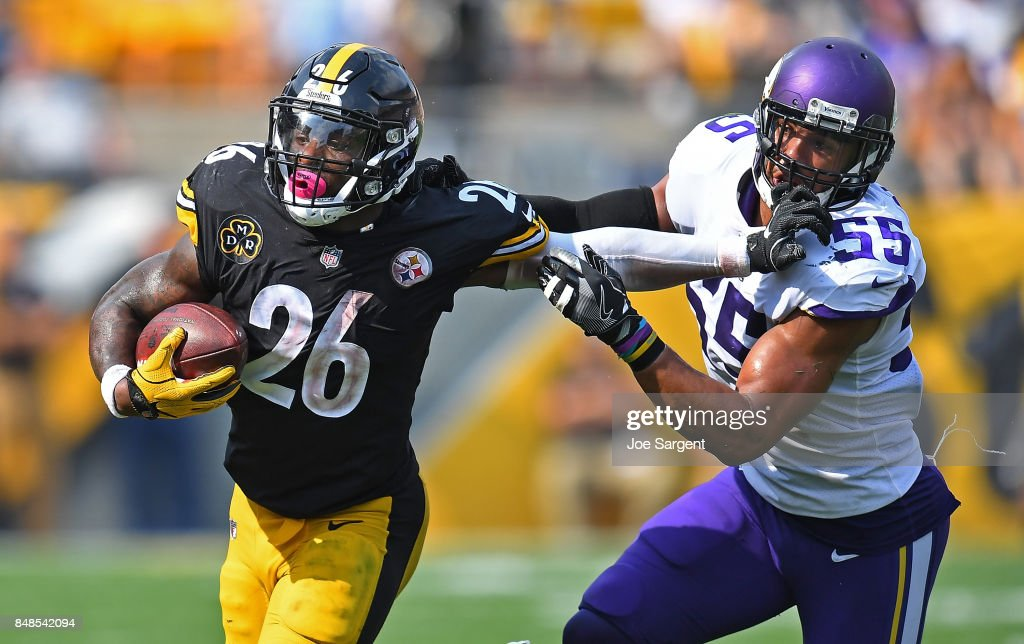 Le'Veon Bell #26 of the Pittsburgh Steelers stiff arms Anthony Barr #55 of the Minnesota Vikings as he carries in the ball in the second half during the game at Heinz Field on September 17, 2017 in Pittsburgh, Pennsylvania.