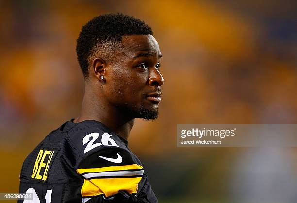 Le'Veon Bell of the Pittsburgh Steelers watches the game from the sideline in the first quarter against the Carolina Panthers during the preseason...
