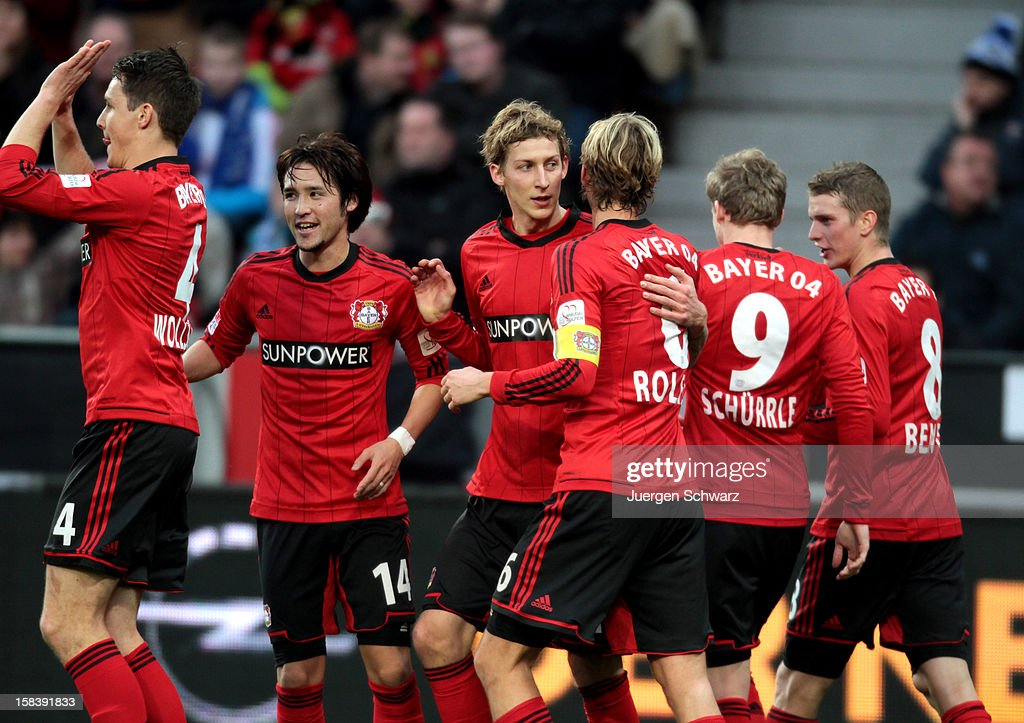 Leverkusen players celebrate after scoring (L-R) <a gi-track='captionPersonalityLinkClicked' href=/galleries/search?phrase=Philipp+Wollscheid&family=editorial&specificpeople=6587656 ng-click='$event.stopPropagation()'>Philipp Wollscheid</a>, <a gi-track='captionPersonalityLinkClicked' href=/galleries/search?phrase=Hajime+Hosogai&family=editorial&specificpeople=4023693 ng-click='$event.stopPropagation()'>Hajime Hosogai</a>, <a gi-track='captionPersonalityLinkClicked' href=/galleries/search?phrase=Stefan+Kiessling&family=editorial&specificpeople=605405 ng-click='$event.stopPropagation()'>Stefan Kiessling</a>, <a gi-track='captionPersonalityLinkClicked' href=/galleries/search?phrase=Simon+Rolfes&family=editorial&specificpeople=635100 ng-click='$event.stopPropagation()'>Simon Rolfes</a>, <a gi-track='captionPersonalityLinkClicked' href=/galleries/search?phrase=Andre+Schuerrle&family=editorial&specificpeople=5513825 ng-click='$event.stopPropagation()'>Andre Schuerrle</a> and <a gi-track='captionPersonalityLinkClicked' href=/galleries/search?phrase=Lars+Bender&family=editorial&specificpeople=644948 ng-click='$event.stopPropagation()'>Lars Bender</a> during the Bundesliga match between Bayer Leverkusen and Hamburger SV at BayArena on December 15, 2012 in Leverkusen, Germany.