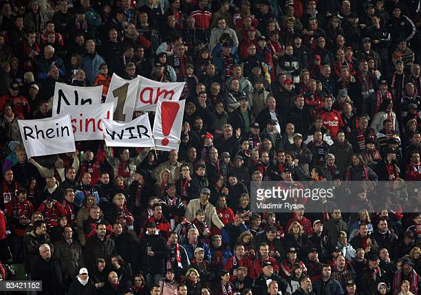 Leverkusen players present a banner during the Bundesliga match between Bayer Leverkusen and 1 FC Koeln at the BayArena on October 24 2008 in...