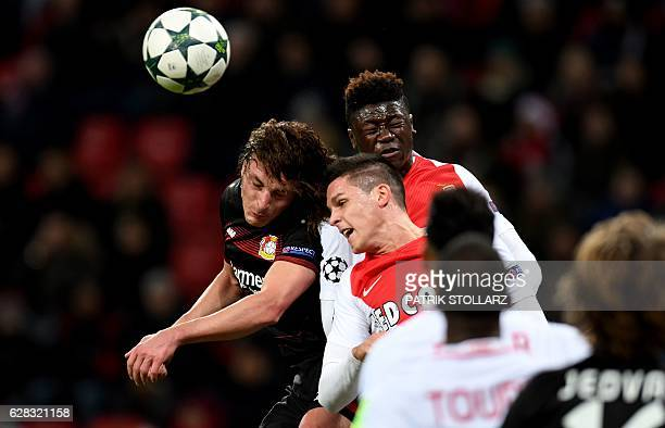 Leverkusen's Austrian midfielder Julian Baumgartlinger Monaco's Argentinian forward Guido Carrillo and Monaco´s Kevin N´Doram vie for the ball during...