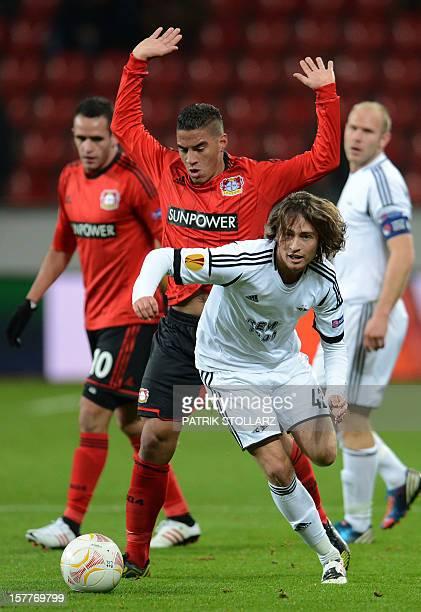 Leverkusen's Brazilian defender Carlinhos and Rosenborg´s US midfielder Mkkel Diskerud vie for the ball during the UEFA Europa League Group K...