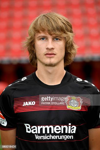 Leverkusen's Croatian defender Tin Jedvaj poses during a team presentation of Bayer Leverkusen on July 25 2016 in Leverkusen western Germany / AFP /...