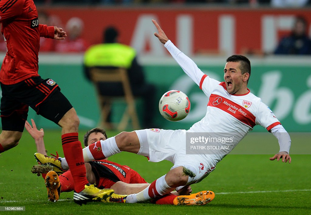 Leverkusen's defender Daniel Schwaab (C) and Stuttgart's Bosnian striker Vedad Ibisevic vie for the ball during the German first division Bundesliga football match Bayer Leverkusen vs VfB Stuttgart in Leverkusen, western Germany on March 2, 2013.