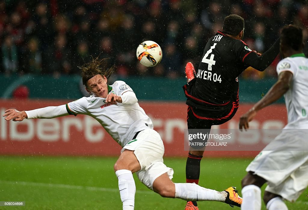 Leverkusen's defender Jonathan Glao Tah (R) and Bremen's Danish defender Jannik Vestergaard vie for the ball during the German Cup ( Pokal ) quarter final football match Bayern 04 Leverkusen v SV Werder Bremen on February 9, 2016 in Leverkusen. / AFP / PATRIK STOLLARZ / AT +49 69 67880 /