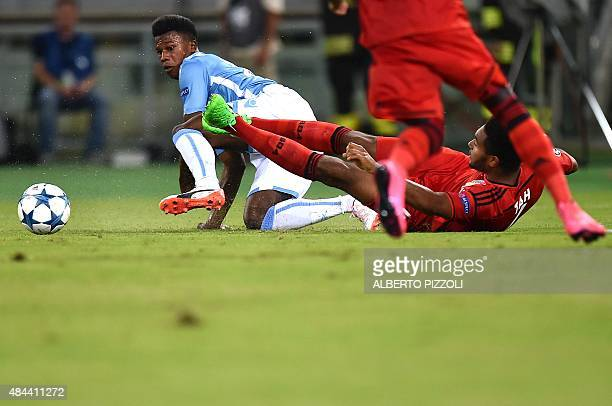 Leverkusen's defender Jonathan Glao Tah vies with Lazio's forward from Senegal Balde Diao Keita during the UEFA Champions League playoff football...