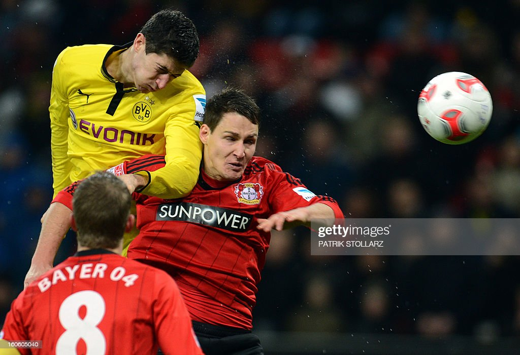 Leverkusen's defender Philipp Wollscheid and Dortmund's Polish striker Robert Lewandowski (L) vie for the ball during the German first division Bundesliga football match Bayer Leverkusen vs Borussia Dortmund in the western German city of Leverkusen on February 3, 2013. Dortmund won the match 2-3.
