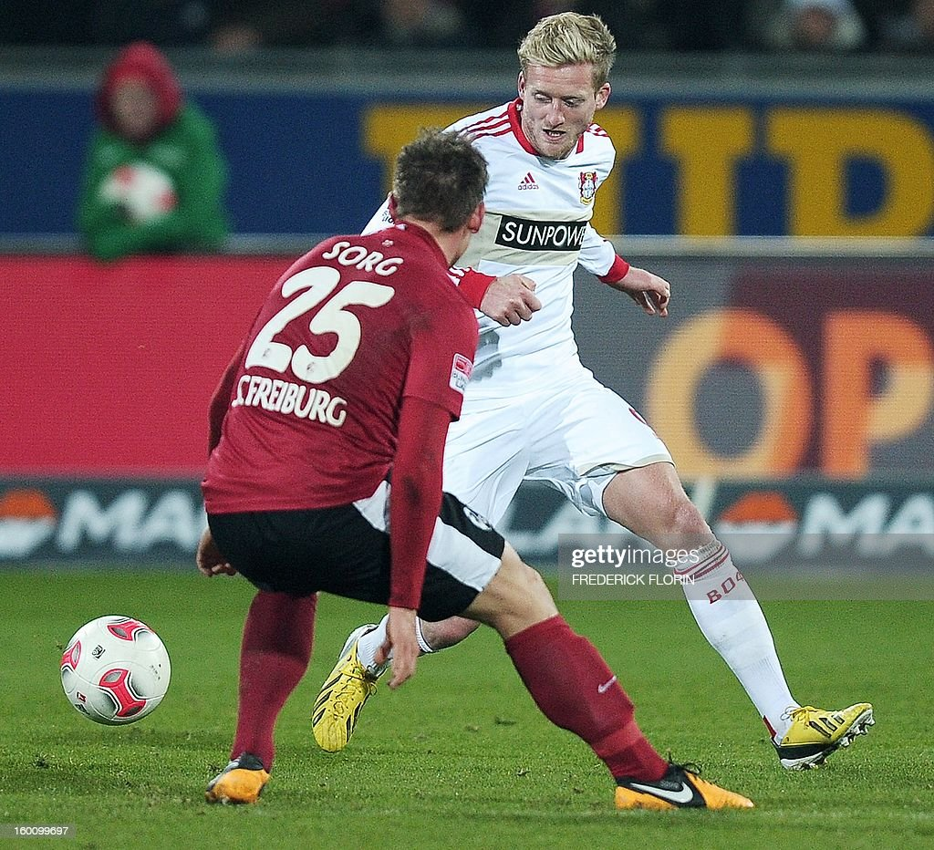 Leverkusen's forward Andre Schuerrle (R) vies with Freiburg's defender Oliver Sorg during the German first division Bundesliga football match SC Freiburg vs Bayer 04 Leverkusen in Freiburg, southern Germany, on January 26, 2013. The match ended 0-0.