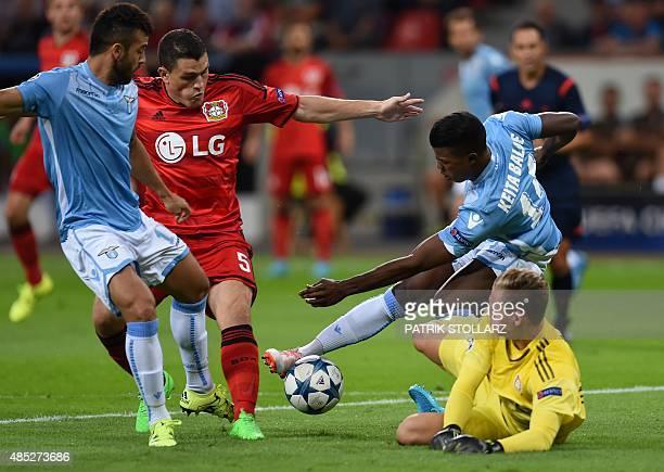 Leverkusen's goalkeeper Bernd Leno Leverkusen's Greek defender Kyriakos Papadopoulos Lazio's forward from Senegal Balde Diao Keita and Lazio's...