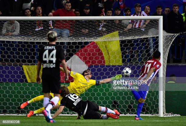 Leverkusen's goalkeeper Bernd Leno stops a ball kicked by Atletico Madrid's Argentinian forward Angel Correa during the UEFA Champions League round...