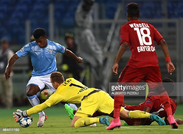 Leverkusen's goalkeeper Bernd Leno vies with Lazio's forward from Senegal Balde Diao Keita during the UEFA Champions League playoff football match...