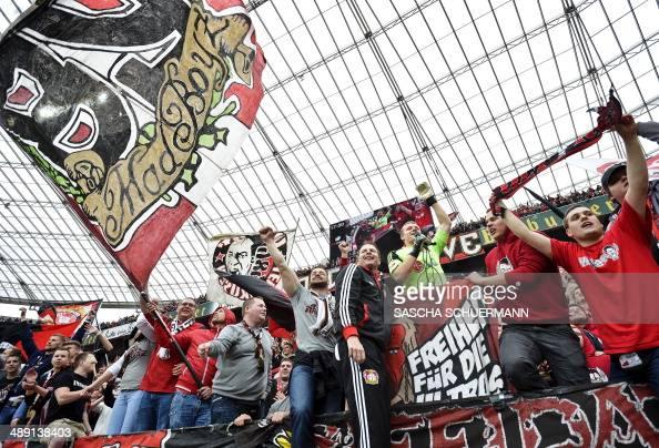 Leverkusen's head coach Sascha Lewandowski celebrates with supporters after the German first division Bundesliga football match Bayer 04 Leverkusen...