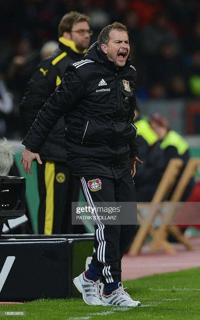Leverkusen's head coach <a gi-track='captionPersonalityLinkClicked' href=/galleries/search?phrase=Sascha+Lewandowski&family=editorial&specificpeople=5134760 ng-click='$event.stopPropagation()'>Sascha Lewandowski</a> reacts after the German first division Bundesliga football match Bayer Leverkusen vs Borussia Dortmund in the western German city of Leverkusen on February 3, 2013. Dortmund won the match 2-3.