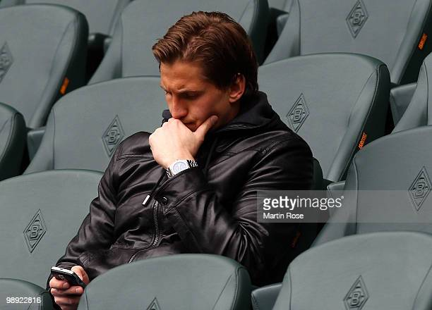 Leverkusen's injured goalkeeper Rene Adler is seen prior to the Bundesliga match between Borussia Moenchengladbach and Bayer Leverkusen at Borussia...