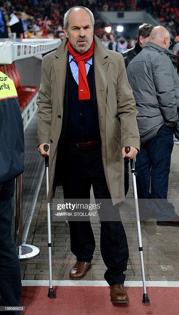 Leverkusen's manager Wolfgang Holzhaeuser walks on cruches prior to the German first division Bundesliga football match Bayer Leverkusen vs FC Schalke 04 in the German city of Leverkusen on November 17, 2012.