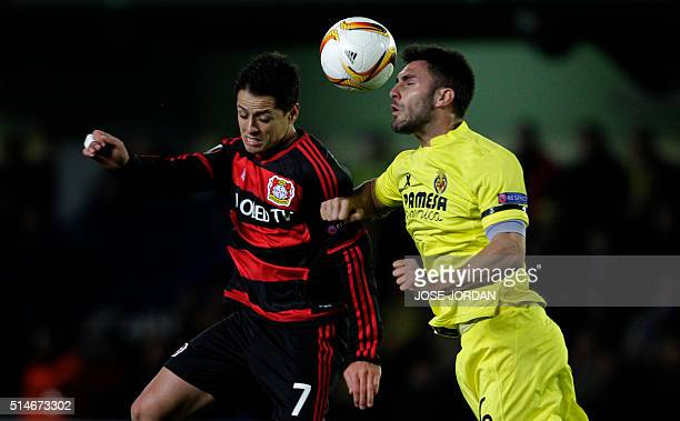 Leverkusen's Mexican forward Chicharito vies with Villarreal's defender Victor Ruiz during the UEFA Europa League Round of 16 first leg football...