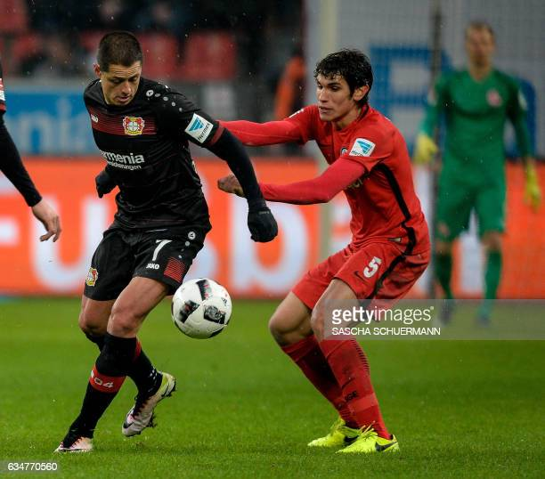 Leverkusen's Mexican forward Javier Hernandez and Frankfurt's Spanish defender Jesus Vallejo vie for the ball during the German First division...