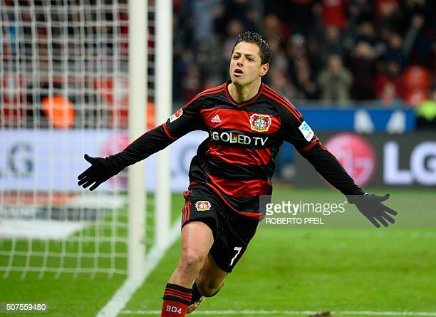 Leverkusen's Mexican forward Javier Hernandez celebrates after scoring during the German first division Bundesliga football match of Bayer 04...