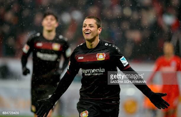 Leverkusen's Mexican forward Javier Hernandez celebrates scoring his 20 during the German First division Bundesliga football match between Bayer...