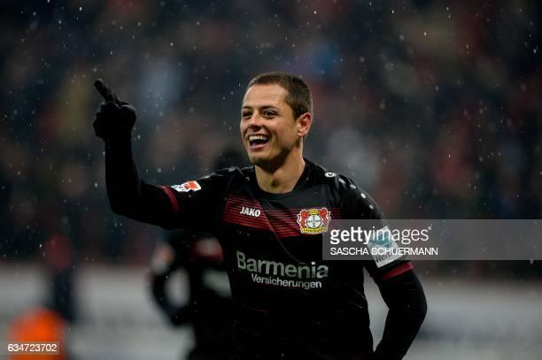 Leverkusen's Mexican forward Javier Hernandez celebrates scoring the 20 during the German First division Bundesliga football match between Bayer...