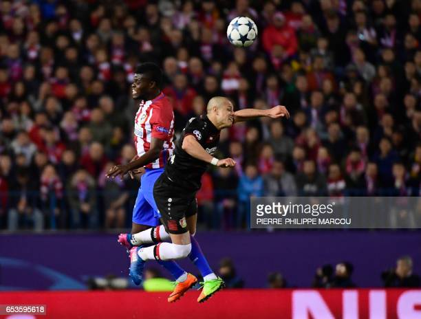 Leverkusen's Mexican forward Javier Hernandez vies with Atletico Madrid's Ghanaian midfielder Thomas Partey during the UEFA Champions League round of...