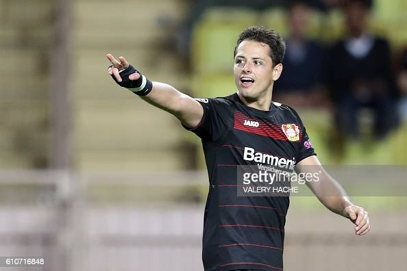 Leverkusen's Mexican forward Javier Hernández Balcázar celebrates after scoring a goal during the UEFA Champions League football match AS Monaco vs...