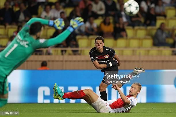 Leverkusen's Mexican forward Javier Hernández Balcázar kicks the ball despite Monaco's Polish defender Kamil Glik during the UEFA Champions League...