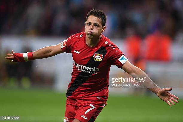 Leverkusen's Mexican striker Javier 'Chicharito' Hernandez and his teammates celebrate after scoring during the German first division Bundesliga...