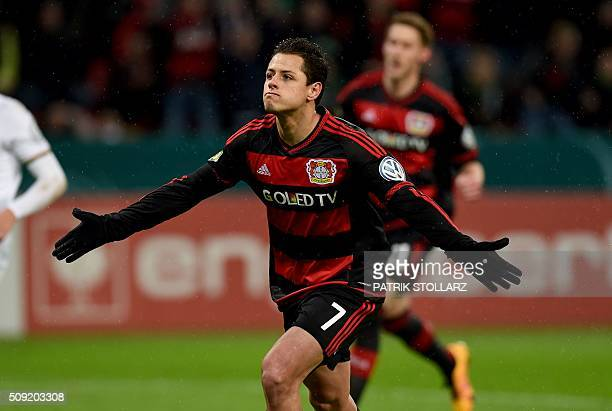 Leverkusen's Mexican striker Javier Hernandez celebrates after a goal during the German Cup quarter final football match Bayern 04 Leverkusen v SV...