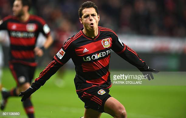 Leverkusen's Mexican striker Javier Hernandez celebrates after scoring his team's second goal during the German first division Bundesliga football...