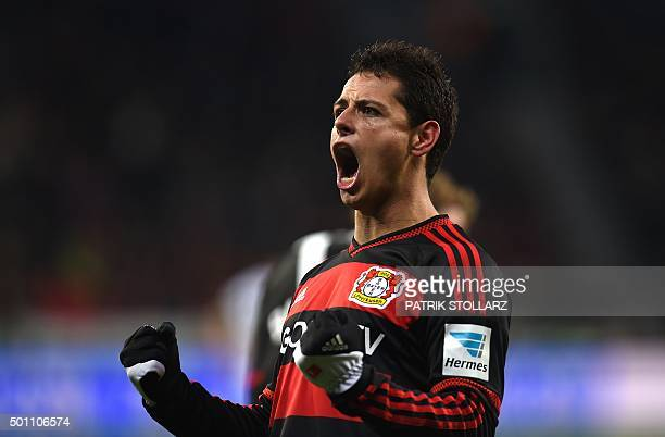 Leverkusen's Mexican striker Javier Hernandez celebrates after scoring his team's second goal during the German first division Bundesliga football...