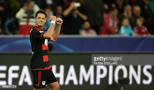 Leverkusen's Mexican striker Javier Hernandez celebrates scoring during the UEFA Champions League group E first leg football match between Bayer 04...