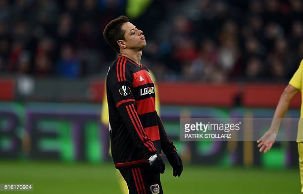 Leverkusen's Mexican striker Javier Hernandez reacts during the UEFA Europa League Round of 16 second leg football match Bayer Leverkusen vs...