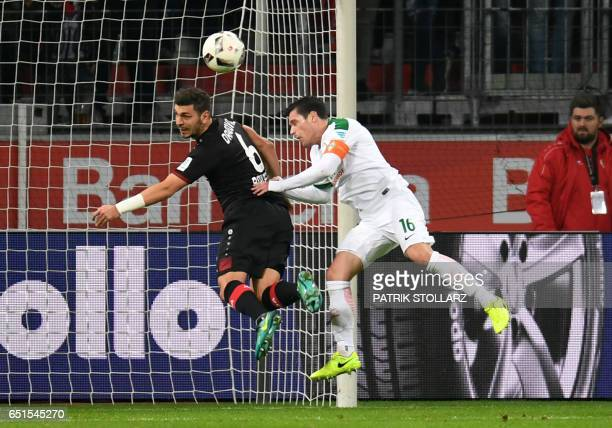 Leverkusen's midfielder Aleksandar Dragovic and Bremen's Austrian midfielder Zlatko Junuzovic vie for the ball during the German First division...
