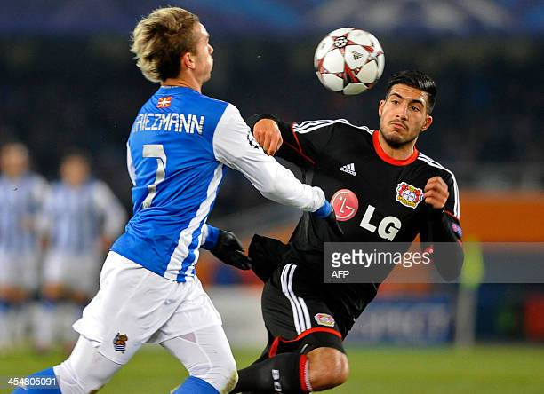 Leverkusen's midfielder Emre Can vies with Real Sociedad's French forward Antoine Griezmann during the UEFA Champions League Group A football match...