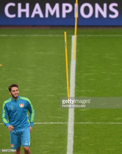 Leverkusen's midfielder Hakan Calhanoglu takes part in a training session in Leverkusen on February 20 2017 on the eve of the Champions League...