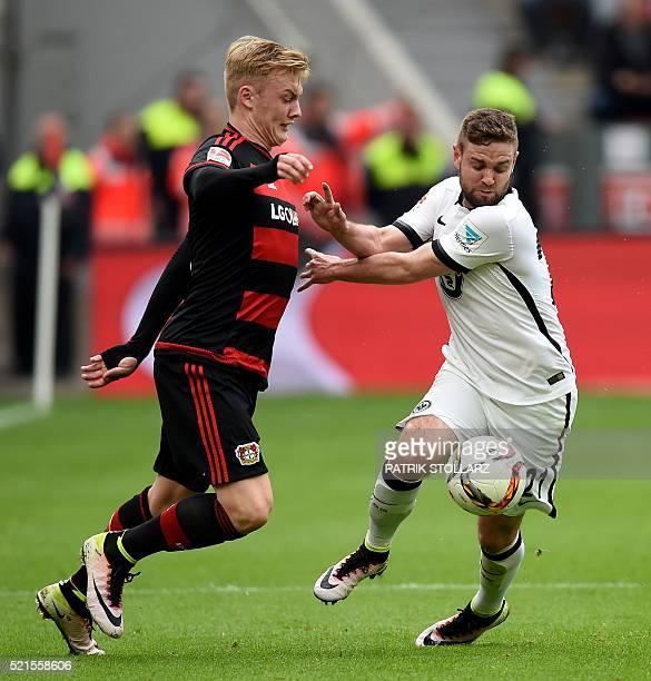 Leverkusen's midfielder Julian Brandt and Frankfurt's midfielder Marc Stendera vie for the ball during the German first division Bundesliga football...