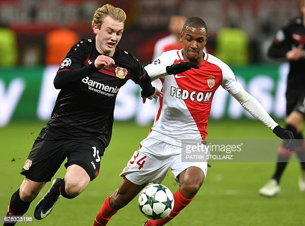 Leverkusen's midfielder Julian Brandt and Monaco's Abdou Diallo vie for the ball during the UEFA Champions League group E football match between...