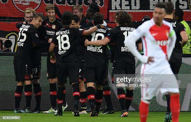 Leverkusen's midfielder Julian Brandt celebrates scoring with his teammates during the UEFA Champions League group E match between Bayer 04...