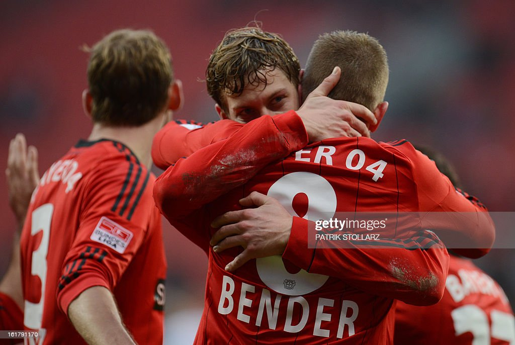 Leverkusen's midfielder Lars Bender (R) and Leverkusen's striker Stefan Kiessling (C) celebrate after Bender scored the 2-0 during the German first division Bundesliga football match Bayer Leverkusen vs FC Augsburg in Leverkusen, western Germany, on February 16, 2013.